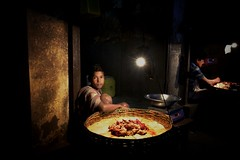 Meat market, Kolkata (paola ambrosecchia) Tags: night light market people street asia india color dark man child kolkata