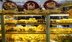 Modern bakery with different kinds of bread (phuong.sg@gmail.com) Tags: assortment bagel baguettecereals baked bakery bread bun business cakes confectionary counter cream croissant different doughnut eating fancy filled french fresh glass grain granary healthy kinds loaf medium modern pastry price retail sell shelves shop showcase small sponge stand stock store storefront sweet trade simple