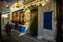 Traditional House (rodiann) Tags: rhodes rodi rhodos greece grecia grece elderly outdoor street cat blue white window leaves lamps sky architecture