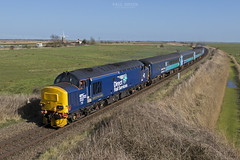 37423 approaches Stracey Arms working 2P21 1317 Great Yarmouth - Norwich 15/3/2017 (Paul-Green) Tags: class 37 374 37423 37425 stracey arms a47 acle straight road canon 7d mk2 mark ii 1317 gt great yarmouth norwich passenger service flickr uk gb railways norfolk english electric type 3 three loco engine diesel locmotive march 2017 outdoors tracks fields shot photography lchs stock aga abellio greater anglia drs direct rail services windmill background spirt of the lakes concrete bob 2p21