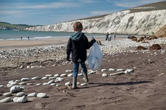Sack (SurfersAgainstSewage) Tags: boy kids binbag sack beach sea cleaner