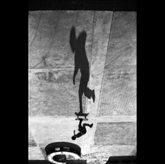 pushing (Mich Alias) Tags: pentax spotmatic sports skate skateboard skater shadow perspective monochrome analog action 35mm film rollei retro guy ilfosol epson scanner pentacon lens 29mm m42 vintage black white