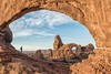 Walking Through a Window at North Window Arch in Arches National Park, Utah. (mnryno) Tags: person northwindowarch arches rock travel nikond750 nikon nature turretarch northwindow archesnationalpark sunrise landscape utah moab