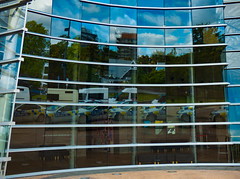 Here Comes The Police (Steve Taylor (Photography)) Tags: monkypolis herecomesthepolice police art architecture building blue green yellow glass newzealand nz southisland canterbury christchurch city curve window car reflection cloud artgallery