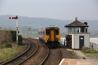 Northern Rail 2C30 Carlisle to Lancaster passes Arnside signal box approaching Arnside Station with BR Metro Cam Sprinter 156491 and a unidentified BR Leyland Sprinter 153 on 1st May 2017 ©