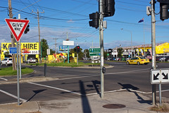 Ashley Street & Ballarat Road, Braybrook Melbourne Victoria Australia 2017-04-11 15:05:27 (s2art) Tags: 60d canon australia stephenshore brayboork melbourne victoria australa placesotherthanhome autumn light ballarat ashleystreet ballaratroad auspctagedpc3019 red yellow blue urban urbanlandscape topographics newtopographics west westernsuburbs facingeast homage sign sigsn signs giveway yield yieldsign arrows arrowspointingsign flag australianflag