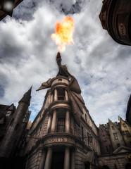 that dragon fire (Eddy Alvarez) Tags: fire flame harry potter gringotts escape from universl studios orlando florida destination movie dragon statue sky clouds fantasy vacation