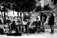 Having fun (Roi.C) Tags: streetmusic street people candid rome italy europe blackwhite black white outdoor nikkor nikond5300 nikon monochrome sitting seated singer guitar band
