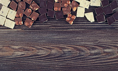 set of chocolates  on dark wooden table (♥Oxygen♥) Tags: closeup over wood tasty collection delicious white sweet view brown cell set wooden vintage background grunge chocolate gourmet food black cocoa dark hot box rustic
