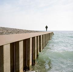 Solitary (marysmyth(NOLA13) ️) Tags: film kodakportra400 lakeontario man mediumformat pier rolleiflex28eplanar solitary square thebeach toronto water