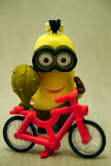 Minions 52 - Inventing The Wheel (Topic 44) (cazphoto.co.uk) Tags: panasonic lumix dmcgx8 panasonic45mmf28leicadgmacroelmaritasph toybox2017 150417 toyboxapr2017 minions52 52weeks2017 topic44 minions kevin crominion bicycle red wheel invention ancestor clever