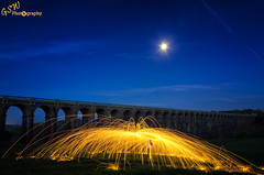 Spinning Gold (Gavmonster) Tags: nikon nikond7000 d7000 gswphotography landscape clouds sky land viaduct balcombe sussex uk unitedkingdom arches train railway lightpainting moon gradeiilisted longexposure grass bridge ousevalley london brighton blue gold green 30seconds westsussex night evening wirewool circle spinning steelwool sparks