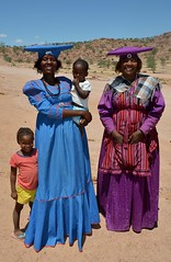 Herero woman in their traditional victotian dresses, dwell in the western regions of Namibia. (One more shot Rog) Tags: himba damara agrican tribesdressestraditionalnamibianamibian tribastribaldressafricaafrican peopleafrican peoplenamibian tribesone more shot rog