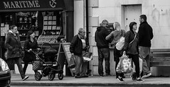 Queueing at the ATM (JmiaJ) Tags: artm automatic danskebank donaghadee money queue street teller bags cash coop community jewellers machine mother people pushcahir queueing shoppers shopping smiles withdrawals