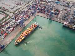Logistic port, vessel transportation and import (anekphoto) Tags: drone sea port morning logistics ship container shipping cargo import export business trade crane harbor transportation view city manufacturing dock harbour terminal sky water technology frame work construction industry structure high industrial transport global town boat machine commerce dusk thailand storage vessel delivery truck pier lift freight bangkok loading unloading shipyard freighters