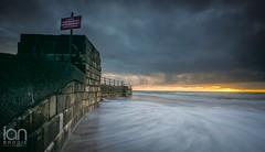 Incoming (ianbrodie1) Tags: scarborough sea seaside seascape wall bricks blocks water ocean sunrise cloudsstormssunsetssunrises cloud nikon d750 leefilters yorkshire coast coastline sign warning