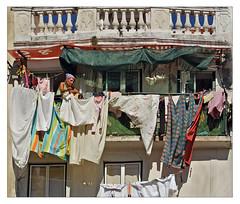 all clean now (me*voilà) Tags: lisbon portugal houses woman laundry windows fassade