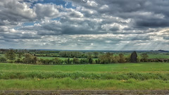 Looking Over The Flat Lands. (ManOfYorkshire) Tags: southyorkshiore lincolnshire nottinghamshire northnottinghamshire bawtry a631 view across vale flatlands flatland vista countryside england agriculture clouds sun rays spring trees boundary boundaries counties county