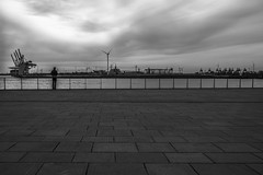 lonesome and a long way from home (moltofredo) Tags: bw black white sw schwarz weiss noiretblanc monochrome street streetlife streetphotography silhouette human urban perspektive perspective