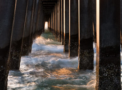 under the Naples pier (marianna_a.) Tags: naples pier florida water motion movement sunset mariannaarmata