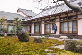 Young couple in traditional Japanese house with moss garden
