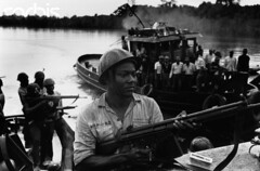 Biafran Soldiers on Oguta Lake 1969 (ogutaboy84) Tags: africa people men water river soldier holding gun military rifle weapon transportation nigeria blacks males tugboat adults watercraft biafra africans ibo 1andgroup nigerians militarypersonnel biafranwar19671968