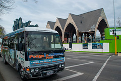 A Bus Load of Penguins (Jocey K) Tags: road street newzealand christchurch sky people signs church architecture clouds fence buildings penguins vehicles van knoxchurch earthquakerepair