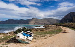 A wreck (jeff_006) Tags: sea sky italy cloud mountain seascape travelling landscape boat san mediterranean hiking path wave olympus lo panasonic sicily capo f28 vito holyday choppy 1238 em5