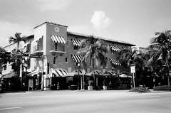 Espanola Way South Beach (Phillip Pessar) Tags: camera bw white black film beach analog store florida zoom kodak miami infinity tx south trix olympus x thrift 400 tri 70 sobe 34mm