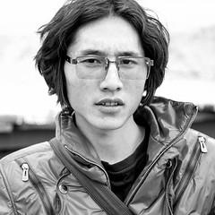 Glass (kevinschoenmakers) Tags: china travel boy portrait blackandwhite bw man guy monochrome square asian glasses blackwhite asia chinese tibet dude tibetan bro minority eastasia eastasian minorities