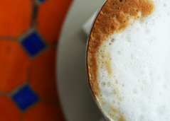 Corinth (blueverbena) Tags: orange coffee breakfast tile 50mm brunch cappuccino primelens fixedfocallength