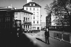 i am legend (matthias hämmerly) Tags: zürich zuerich switzerland candid street streetphotography sun shadow contrast grain ricoh gr black white bw monochrom monochrome city town urban morning lonely walk man elderly light