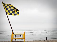 Waving Flag (iamamylou) Tags: flag yellowandblack checkered sign ocean beach waves sand yellow color wind blowing pacificbeach outside outdoors