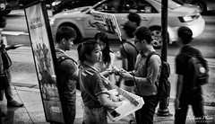 The promoter and her bottles (gunman47) Tags: 2015 asia asian b bw east mono monochrome plaza sea sg sepia singapore singapura south vitagen w black bottle bus lady man marketing photography promoter promotion stop white woman young people
