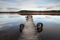 Early spring - Fryken (- David Olsson -) Tags: kil fryksta fryken lake värmland sweden water jetty pier brygga tires däck wooden centered clouds afternoon spring cold landscape seascape lakescape reflection reflections mirrored mirror calm quiet serene leefilters 06hard gnd grad nikon d800 1635 1635mm 1635vr vr fx davidolsson 2017 april