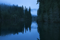 Toketee Lake (Curtis Gregory Perry) Tags: toketee lake oregon water reflection trees idleyld park blue hour sky clouds night longexposure nikon d810 50mm f12 north umpqua river fog