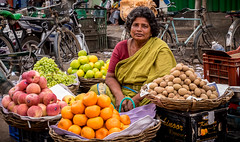 Fruit & spuds for sale (Wanda Amos@Old Bar) Tags: india wanda©amos fruit grapes lady markets oranges potatoes seller stall street trade womanatwork spuds food environmentalportrait portrait