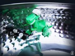 Skating Rex (jezbags) Tags: lego legos toys toy toystory macro macrophotography macrodreams macrolego canon60d canon 60d 100mm closeup upclose trex rex dinosaur dino green helmet skate skateboard fruit bowl grey white speed minifigure minifigures