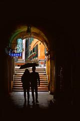 Venetian mood (Rino Alessandrini) Tags: venezia coppia arco passeggio ponti calle venice couple walking bridges arch people men woman dark architecture sreet outdoors silhouette door urbanscene females males shadows city corridor twopeople traveldestinations travel