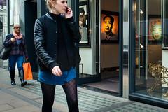 Woman with a Hoop Earing (stevedexteruk) Tags: woman gallery mayfair tiger lion art painting mobile phone mao tsetung tse tung zedong chairman bond street london w1 uk city westminster 2017 marilyn monroe earing