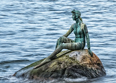 A Spring Swim (Coral Norman) Tags: statue swimmer swimming swim spring springtime art rock diver snorkle dive rest sit sitting resting stanley park vancouver stone carve carving monument girl woman pony tail goggles bathing suite