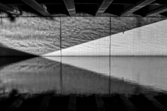 Triangulation (matthewkaz) Tags: bridge overpass underpass river grandriver water reflection reflections angles triangle triangles light elm elmst downtown lansing inghamcounty michigan bw blackandwhite 2017 ripples
