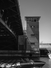 Just passing by. (Lens Cap Tim Photography) Tags: movement photo blackandwhite 50mm d750 nikon passing photography river urban 18st bridge monochrome boat chicago