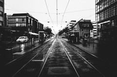 light years away (matthias hämmerly) Tags: switzerland candid street streetphotography shadow contrast grain ricoh gr black white bw monochrom monochrome city town urban blackandwhite strasse people man monochromphotography dark zürich zuerich rain lonely cold winter swiss
