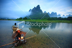 Lijiang-fishermen (MPBHAIBO) Tags: china morning blue summer cloud mountain bird nature fog stone sunrise river landscape dawn liriver landscapes fishing fisherman asia dusk guilin yangshuo hill lifestyle cormorant   relaxation cloudscape stormcloud seniors cumulonimbus  chineseculture   xingping ruralscene fishingindustry   karstformation chineseethnicity  woodenraft   guangxiregion
