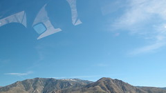 1466. Driver in the sky (lemonhats) Tags: california blue sky mountains reflection america desert palmsprings smallsensor lonesomecrowdedwest olympusxz1 enthusiastcompact advanceddigitalcompact