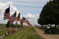 Memorial Day in Colfax (Steven King Photography) Tags: road blue white dusty cemetery grass clouds army us jeep flags memorialday skyred