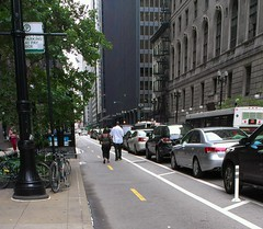 Pedestrians using dedicated bike lane as personal sidewalk.