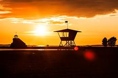 From Under the Mango Tree (Espen Dalmo) Tags: trees light sunset summer people orange lighthouse tower beach yellow canon sand warm sundown lifeguard 135mm 1dsmarkiii