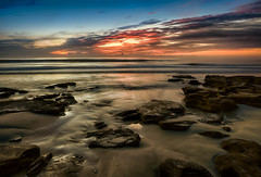 Down on the beach at dawn (Ed Rosack) Tags: ocean blue sky orange usa cloud brown color reflection beach water weather sunrise landscape dawn lowlight day florida cloudy wave explore shore features hdr marineland centralflorida